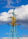 High voltage power line against blue sky with clouds Royalty Free Stock Photo