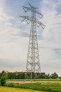 High-voltage power line metal tower with wires vertical view Royalty Free Stock Photo