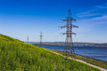High voltage power line on the shore of the river Royalty Free Stock Image