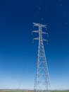 High voltage power line under a blue sky Stock Images