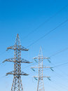 High voltage power lines against the blue sky Stock Photos
