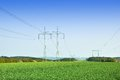 High voltage power lines and countryside Stock Photography