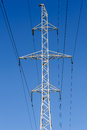 High voltage power lines electric on pylons Royalty Free Stock Image