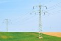 High voltage power lines and fields countryside Stock Images