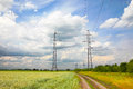 High voltage power lines on the green field Stock Photography