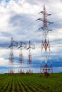 High voltage power lines over blue sky Stock Photos