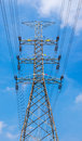 High voltage power pole with blue sky background for power trans Royalty Free Stock Photo