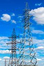 High voltage power pylon against blue sky Stock Image