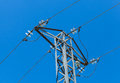 High voltage power pylon against blue sky Royalty Free Stock Photo