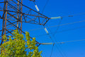 High voltage power pylon against blue sky fragment of Royalty Free Stock Image