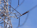 High voltage power pylons against blue sky Royalty Free Stock Photo