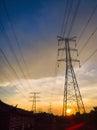 High voltage power pylons in sun set Stock Photo