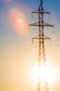 High-voltage power transmission line. Energy pillars. At sunset, dawn. high-tension Royalty Free Stock Photo