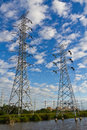 High voltage power transmission lines and pylons Stock Photos