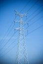 High voltage power transmission tower under the blue sky Stock Photography