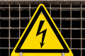 High Voltage Sign bolted on steel grid Royalty Free Stock Images