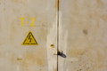 High voltage sign on grey wall