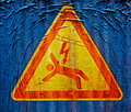 High voltage sign on old and dirty concretel surface Royalty Free Stock Photo