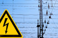 High voltage sign and railway overhead wiring metal danger electric contact wire all over Stock Images