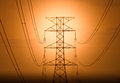 High voltage the silhouette of tower at dawn Royalty Free Stock Image