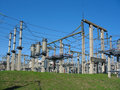 High-voltage substation on blue sky background Royalty Free Stock Photo