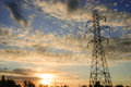 High voltage tower against a sky at sunset Royalty Free Stock Images