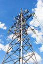 High voltage tower with ragged high voltage line against the blue sky Royalty Free Stock Image