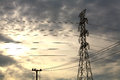 High voltage tower and small electric post Royalty Free Stock Photos