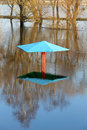 High waters flood at park only the tops of the sunshade Stock Images