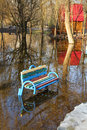 High waters park bench in flood water in ukraine Stock Images