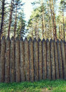 High wooden stockade made of logs in a forest Royalty Free Stock Photography