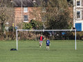 High wycombe uk november high wycombe sports ground man and boy playing soccer together under goal posts Royalty Free Stock Photos