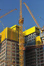 High yellow cranes on construction site Stock Photo