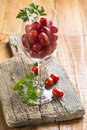 Highball cup with grape tomatoes on a wooden background Stock Image