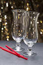 Highball glasses with straws in front of gli Royalty Free Stock Photos