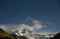 The highest mountain in world at night everest qomolangma is it is main peak of himalayan mountains Stock Photo