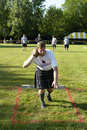 Highland games an athlete prepares to push the stone as for as he can at the st andrew s in livonia mi Stock Image
