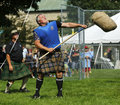 Highland games toss heavy sheaf dirk bishop tosses the at the new brunswick festival july in fredericton canada Stock Photography