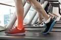 Highlighted ankle of man on treadmill digital composite Royalty Free Stock Image