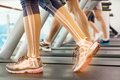 Highlighted ankle of woman on treadmill Royalty Free Stock Photo