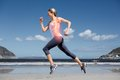Highlighted back bones of jogging woman on beach Royalty Free Stock Photo