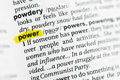 Highlighted English word `power` and its definition at the dictionary Royalty Free Stock Photo