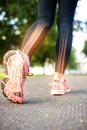 Highlighted foot bones of jogging woman digital composite Royalty Free Stock Images