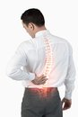 Highlighted spine of man with back pain digital composite Stock Image