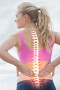 Highlighted spine of woman with back pain digital composite Stock Photos