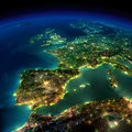 Highly detailed earth illuminated by moonlight the glow of cities sheds light on the detailed exaggerated terrain and translucent Stock Image