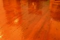Highly polished wood floor wooden floorboards and showing reflections of furniture Stock Image