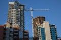 Highrise buildings construction crane blue sky Royalty Free Stock Photo
