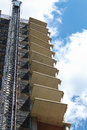 Highrise in progress under construction with crane attached set against a blue sky with clouds Royalty Free Stock Photography
