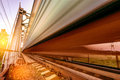 Highspeed train moves fast on the bridge at sunset Royalty Free Stock Images